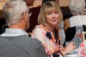 woman talking in a public meeting