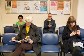 People waiting in a GP Surgery waiting room