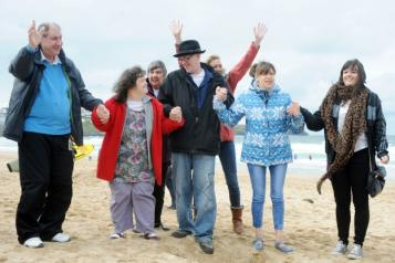 People with additional needs on a beach