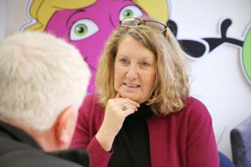 Woman listening during a board meeting