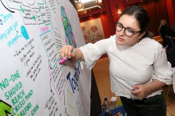 Woman drawing an illustration at a meeting