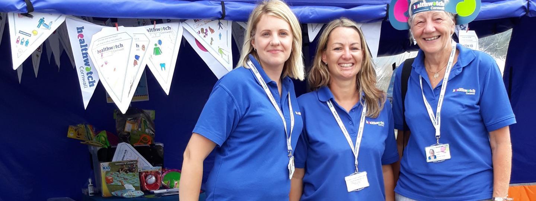 Women outreach workers at a summer fair
